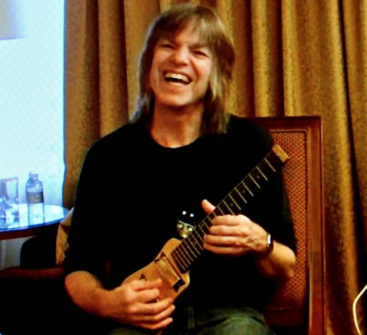 Mike Stern plays a travel guitar fro Lap axe.