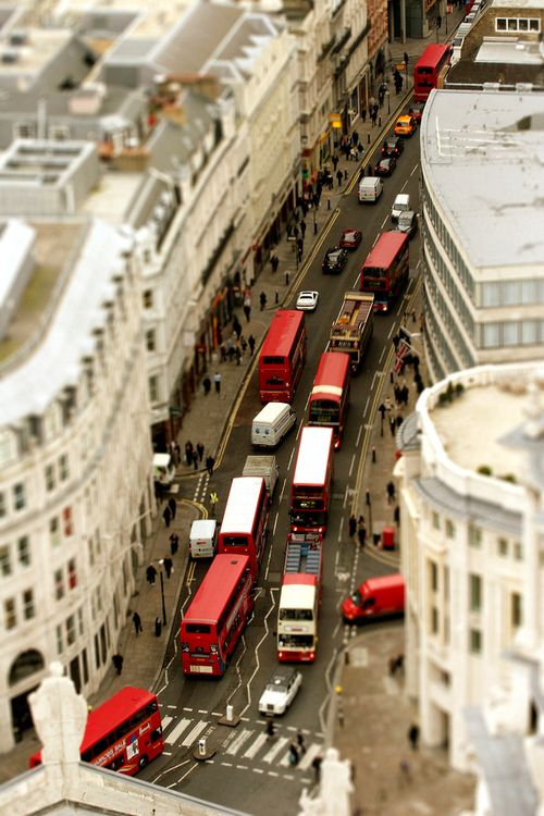 12- An overhead view of central downtown London, with the hustle and bustle of the city.