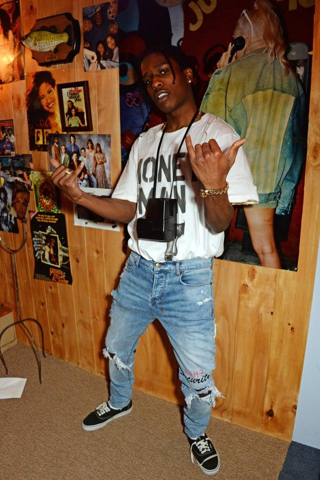 ASAP Rocky wearing Himumimdead Tees, Vans Sneakers and Polaroid Electronics