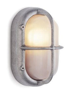Cast aluminium outside lamp with protective guard This lamp is made of cast aluminium and glazed glass facing. It was designed to be mounted on outside pla