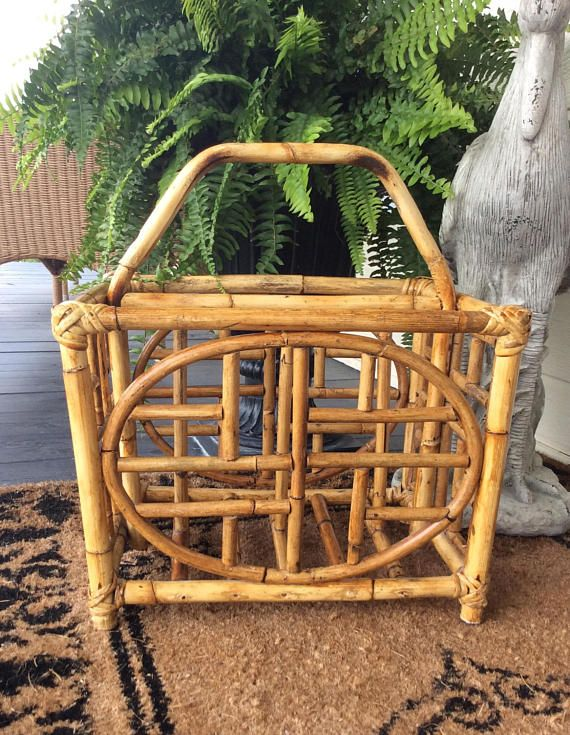 Vintage Asian design bamboo & rattan divided magazine rack. In very good vintage condition with divided storage. Front & back Asian design with top handle for carrying. Large enough for books, magazines, bathroom towels, small blanket or throw. So many uses for such a beautiful home accent piece. Can go in so many home decors from coastal to chinoiserie! Shipped insured! Measures 17.5 height with handle x 16 length x 13 wide Basket storage height 12 height Thanks for shopping YellowH...