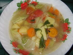 Sayur Sop. One of famous homey vegetable soup for indonesian people. Carrot, cabbage, tomato, stringbean and potato cooked in light chicken/beef broth.