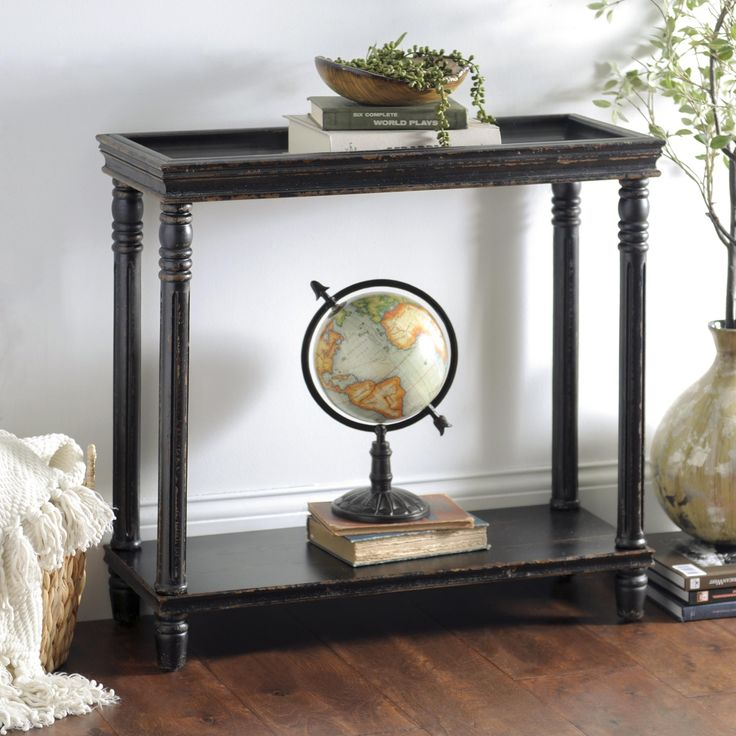De Stress With Our Distressed Black Wooden Console Table. Its Beveled Edge  Tabletop Keeps Precious Display Items In Place While The Lower Fixed Shelf  Acts ...