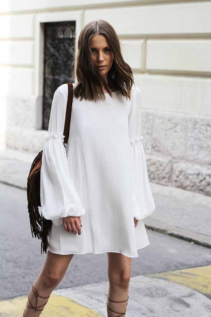 Flowy white dress and lace-up sandals