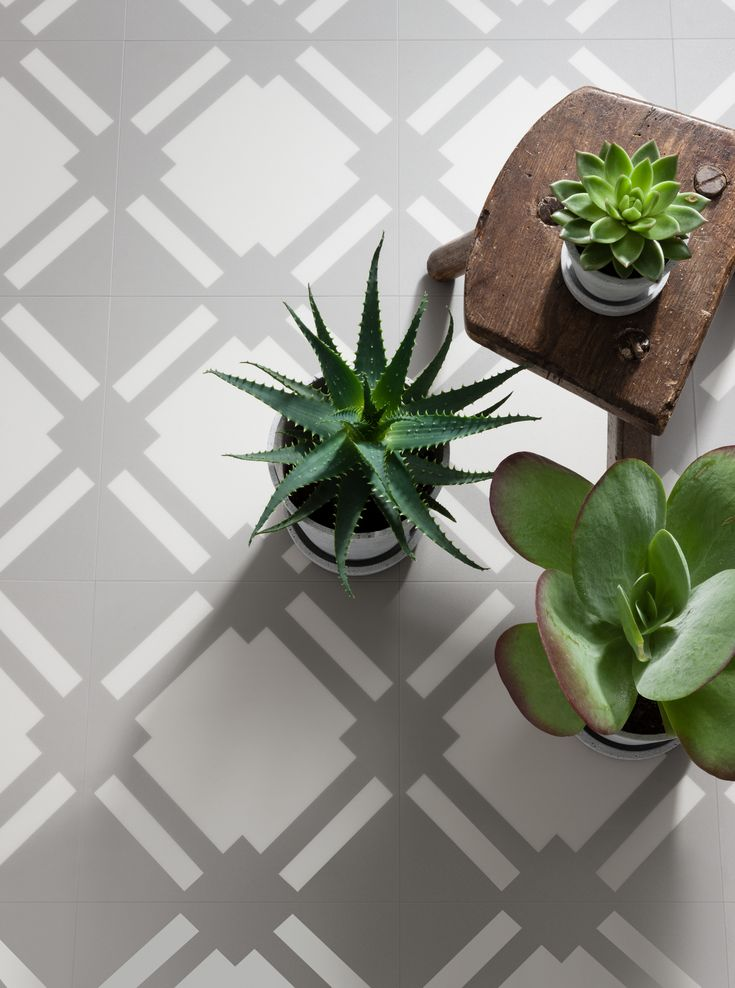 Check features a striking geometric motif that, when laid, transforms into a characterful diamond design reminiscent of period floor styles - Neisha Crosland Check Vinyl Tile in Flint Grey from Harvey Maria. http://www.harveymaria.com/Floor-Range/Neisha-Crosland/check-flint-grey