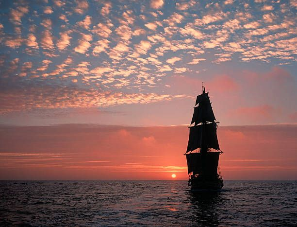 Tall ship, setting sun stock photo