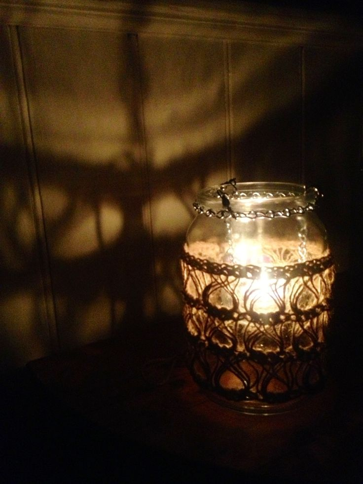 Stand alone Tea light holder... love the way it lights the wall...recycled glass jar, chain and jute used to create this...