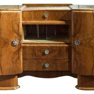 """Fully restored walnut Art Deco buffet/bar with three drawers sliding glass doors, could have come from a stateroom aboard the great steam liners of the early part of the 20th century. Original decorative brass pulls adds to all the graceful curves. Everything about this piece says entertainment. There's enough space for all your silverware, glasses and special china.  H 53""""  D 20""""  W 54"""""""