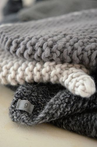 Grey garter stitch - love the charcoal color against the buff background.