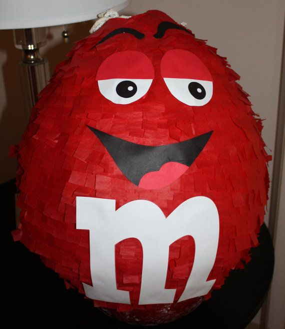 M&M Candy Pinata    This listing is for the pinata and $5 rush fee. This does not include shipping as you will pick the pinata up.    What child does