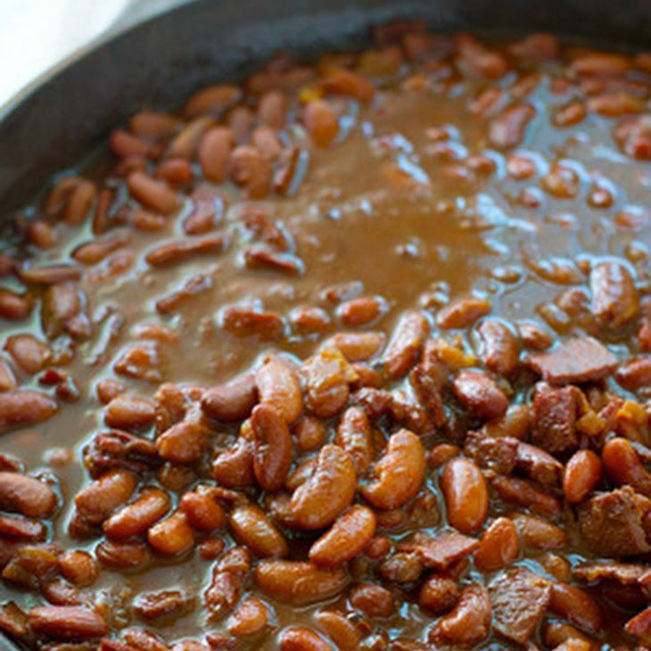 Ultimate Crockpot BBQ Baked Beans Recipe Side Dishes with navy beans, water, salt, vegetable oil, bacon, garlic, onions, tomato paste, dark molasses, coconut sugar, balsamic vinegar, worcestershire sauce, chili powder, salt, pepper