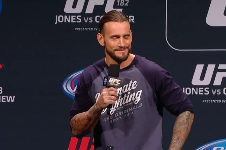 Famous TV Dad Makes Friendly Challenge to CM Punk, Punk on Watching UFC 182 with Shaq (Photo) - http://www.wrestlesite.com/wwe/famous-tv-dad-makes-friendly-challenge-cm-punk-punk-watching-ufc-182-shaq-photo/
