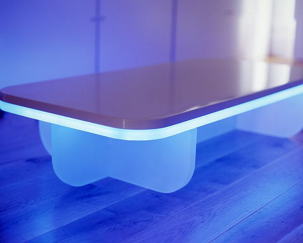 white polyester lacquered coffee table with illuminated blue detailing designed by ben rousseau made