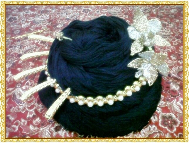 """A Peranakan ladies """"Sanggol"""" or hair piece worn on special occasions"""