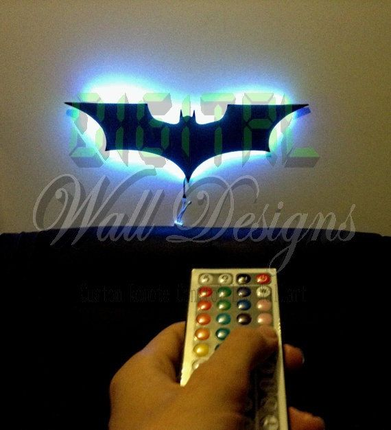 CHECK OUT OUR ITEM IN ACTION HERE!!!!!! --------->>>> https://youtu.be/kNAU93Dqb2U   Decorate your Batcave with this multicolored LED, Remote Controlled backlite Batman Dark knight logo wall Decoration\ nightlight! At just under 1 meter long Its a Big Awesome Gift for any Bat fans home, office, Bedroom or Batcave.   Materials :  2mm Shiny Black gloss acrylic, this is a higher quality material with a flawless finish (production time to manufacture item is 2-3 days)    Bright LEDs: The LED…