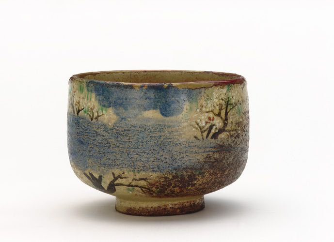 Kenzan-style tea bowl with design of cherry blossoms. Early to mid-19th century. Ogata Kenzan , (Japanese, 1663-1743). Edo period. Buff clay; white slip, iron pigment, and enamels under transparent lead glaze. H: 8.3 W: 11.3 cm. Tokyo, Japan.