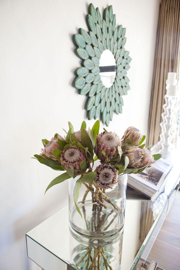 Ocean House, Morukuru, South Africa. Turquoise mirror and protea flowers at reception. #OceanHouse #DeHoop #Morukuru #design #decor
