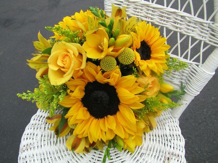 Beautiful Round Wedding Bouquet Which Features: Yellow Sunflowers, Yellow Alstromeria (Peruvian Lily), Yellow Roses, Yellow Craspedia (Billy Balls, Billy Buttons), Yellow Freesia, Yellow Roses, Yellow Solidago (Goldenrod)