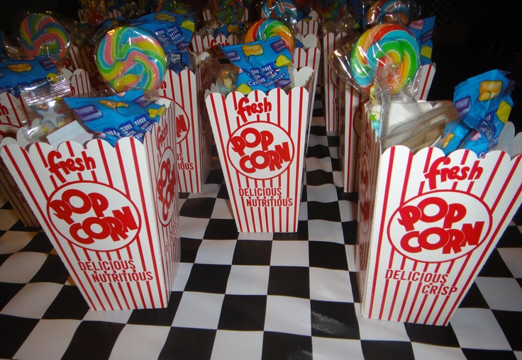"""Goody """"bags"""" for diner/drive-in theme complete with mini wooley willy, PEZ, punching balloons, fortune teller fish, and 1950s candies"""