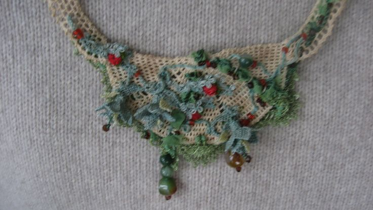a textile necklace with oyas by Muyesser Baykara