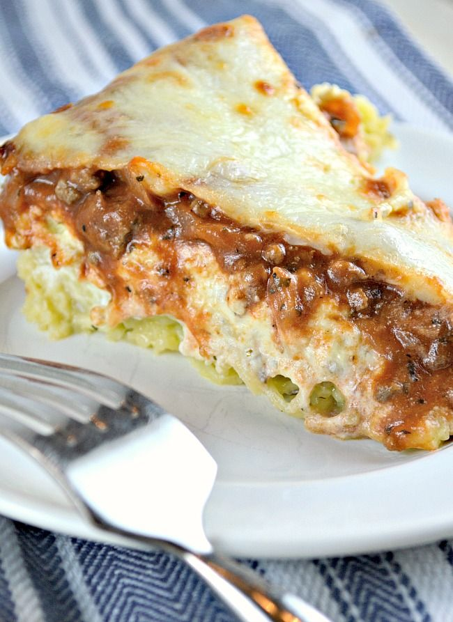 "Spaghetti Pie or What I Like to Call,""Out Of This World, Delicious Parmesan Garlic Angel Hair Pasta with Homemade Meat Sauce and Lasagna Topping! Spaghetti Pie. It's funny, but that name really doesn't describe this dish at all! Spaghetti pie is so plain and boring compared to this amazing dish! This dish really should be …"