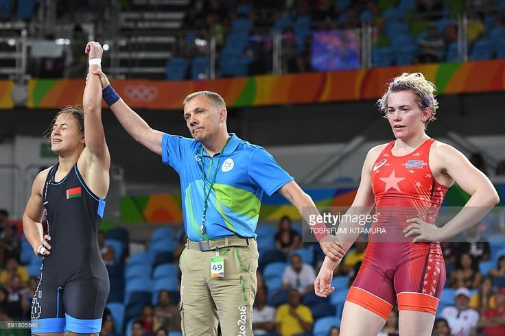 Belarus' Maryia Mamashuk (blue) celebrates winning against US Elena Sergey Pirozhkova in their women's 63kg freestyle semi-final match on August 18, 2016, during the wrestling event of the Rio 2016 Olympic Games at the Carioca Arena 2 in Rio de Janeiro. / AFP / Toshifumi KITAMURA