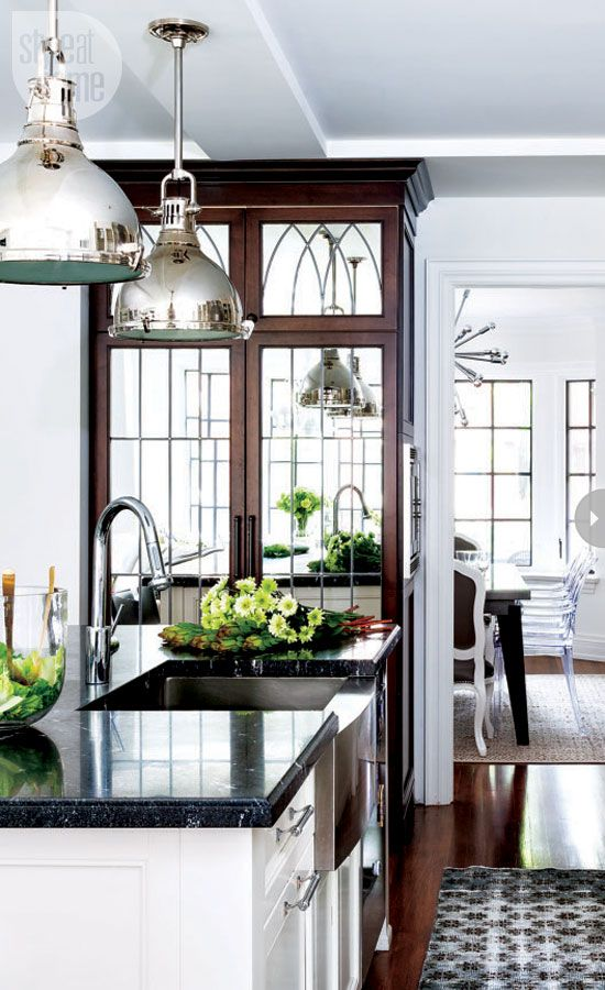 WSH <3 the mirrored pantry doors and the chrome touch of the lighting fixtures.