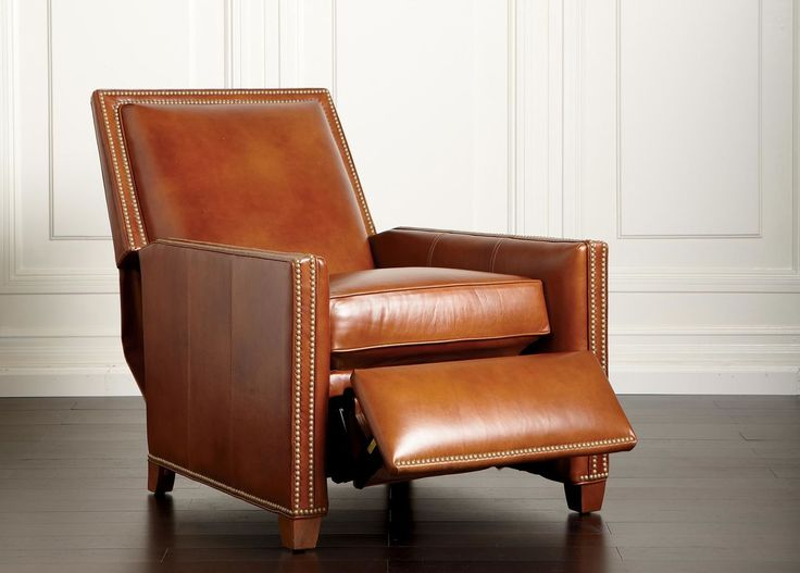 "From Ethan Allen, still one of my all time favorites, It's very expensive but at 40"" high that Randall Leather Recliner is extremely good looking. You didn't include the height of the one you sent me. It's double the price of the one you sent but there are sales! The back may not be tall enough, however, for woody."