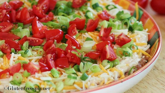 Gluten Free Taco Dip- I love taco dip! It's the best party dish. This isn't quite the recipe I use, but close. Nice to have a gluten free option! I don't usually add refried beans, but like the idea! Also, add olives and jalapenos to make it extra yummy!
