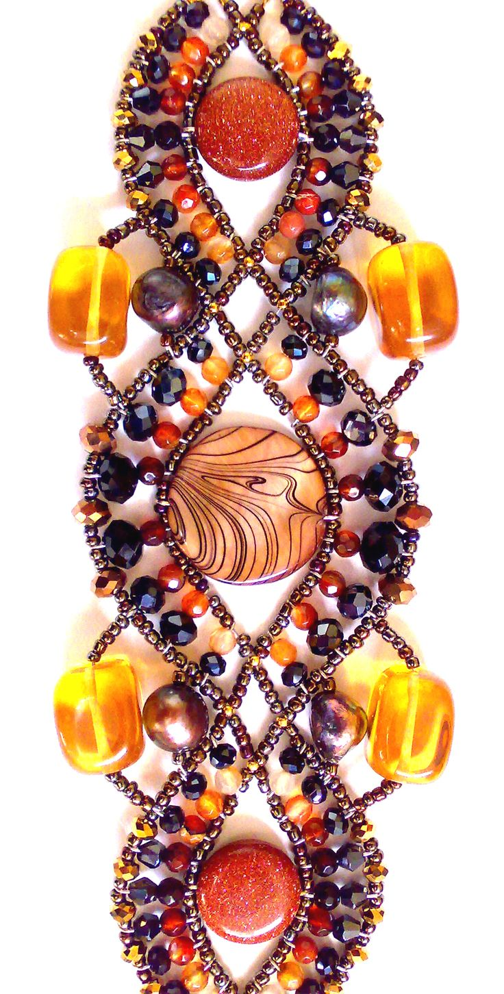 """""""Genetic - Black Pearl & Amber"""" Bracelet from Musesa Collection. Amber, Freshwater Pearl, Mother-Pearl Shell, Agate, SwarovskiCrystals, Sterling Silver tag. www.musesa.com"""