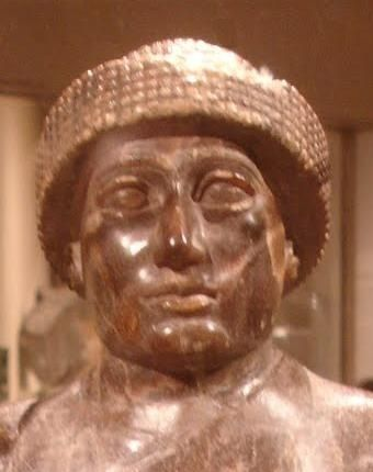 The face of Ur-Ningirsu. Again note the sharp nose, full lips, and rounded chin. See a picture of the entire statue. Both Gudea and Ur-Ningirsu wore the same kind of crown.