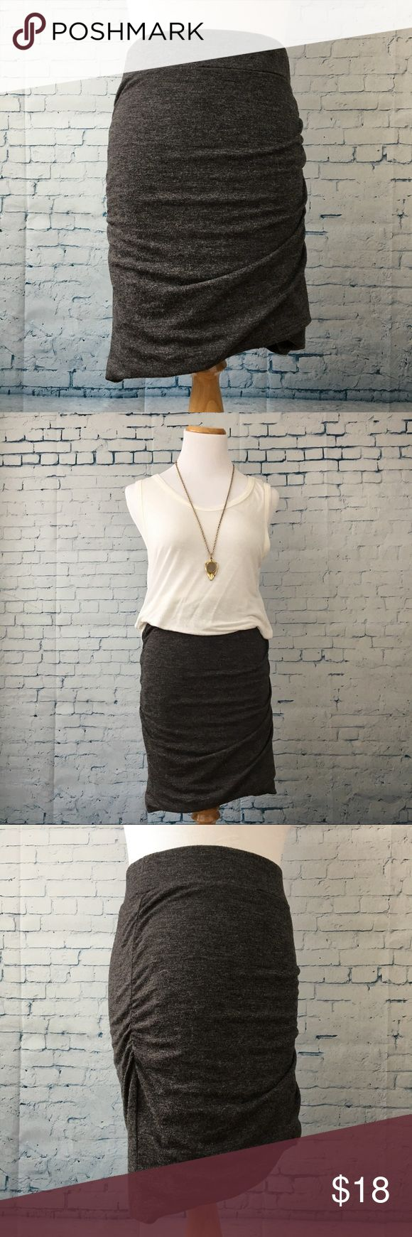 Banana Republic Ruched Jersey Skirt Very flattering. 95% viscose, 5% spandex. Lining is polyester. Dark charcoal- super cute with denim jacket and tshirt, dressed up for the office, or with tights and boots for the fall. Great used condition. Banana Republic Skirts