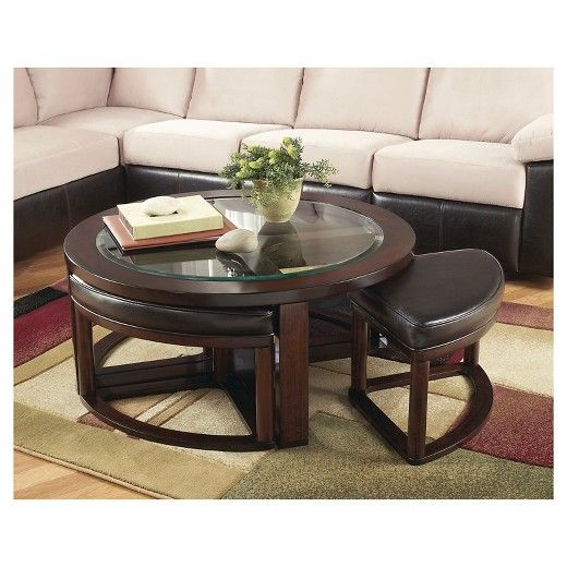 With four wedge-shaped stools seamlessly integrated into its design, this round coffee table might well be your cup of tea. Upholstered in a high-quality faux leather, they're a subtle complement to the burnished wood-color frame.   Signature Design by Ashley is a registered trademark of Ashley Furniture Industries, Inc. $343.99