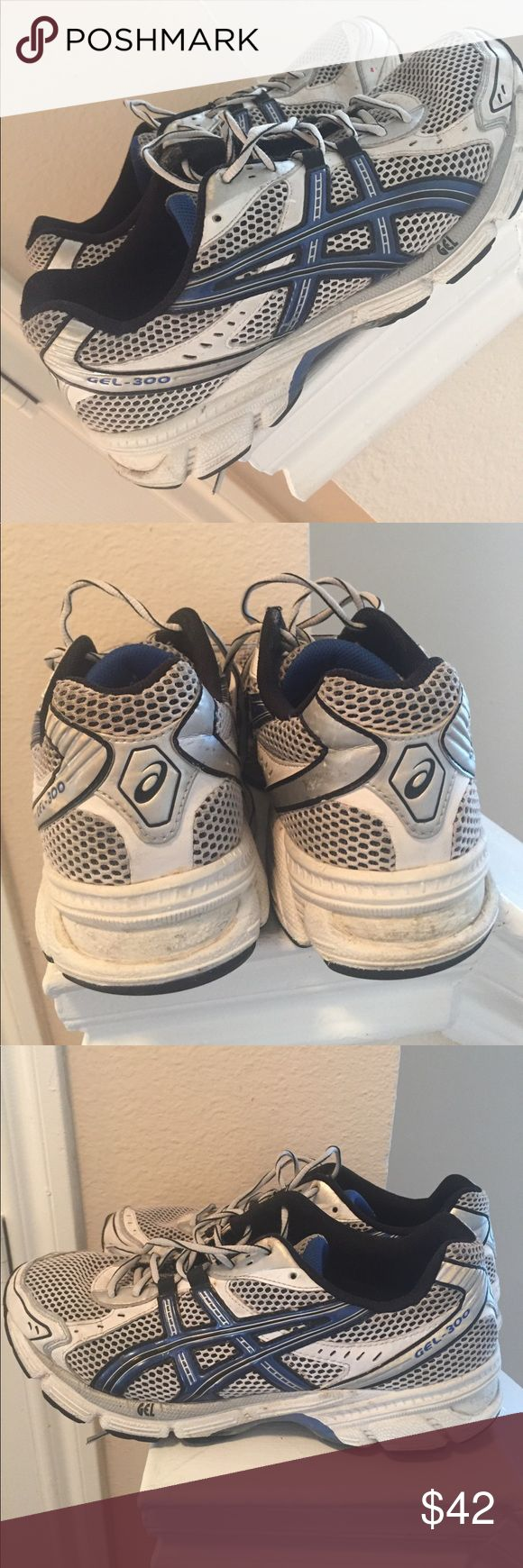 Asics Gel-300 Size 8.5 Men Size 8.5 Asics shoes. Blue, White, and Black. Great running shoes. Well maintained. Everything intact. Very comfortable shoes. Asics Shoes Athletic Shoes