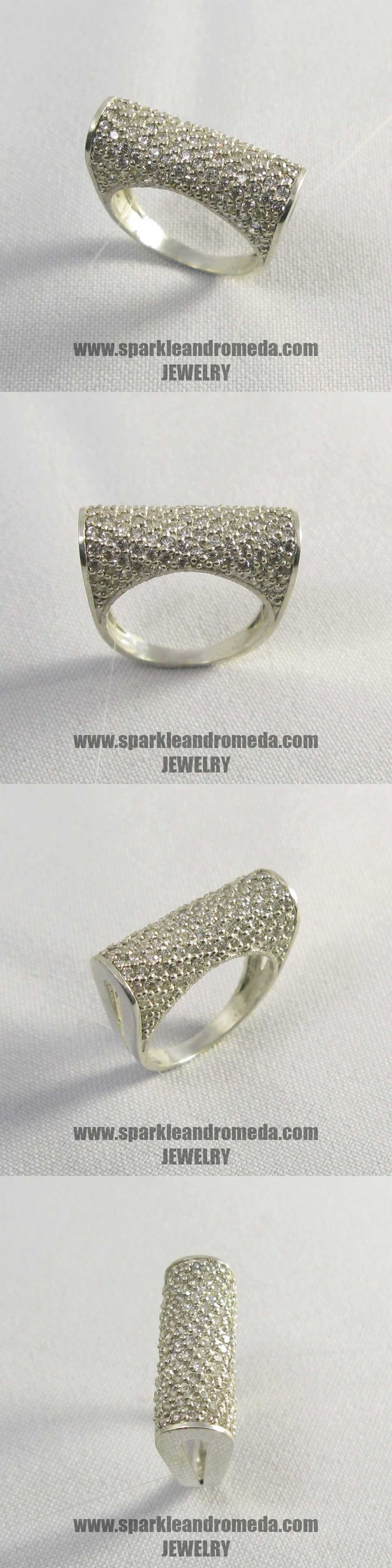Sterling 925 silver ring with 110 round 1,5 mm and 4 round 1,25 mm white color cubic zirconia gemstones.