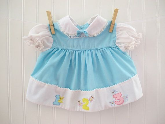 Vintage baby dress with number appliques, 1970's.