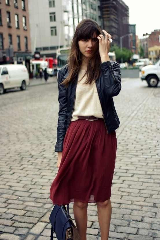 Flowy skirt, fine knit crew neck sweater and black leather jacket.