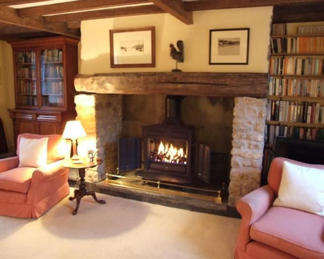photo of beige brown red with fireplace wood burner farm house