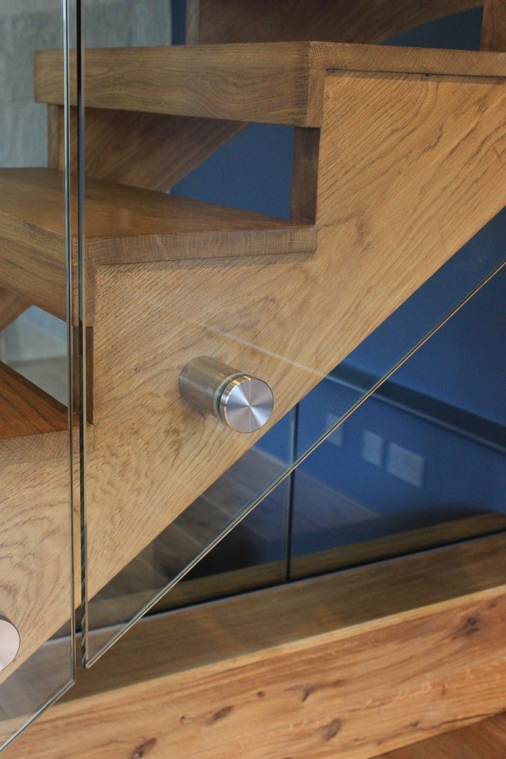 Oak staircase with frameless glass balustrade with stainless steel bolted…