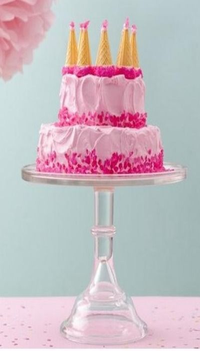 Pink castle cake . . . could make one blue maybe for Elsa's ice castle?