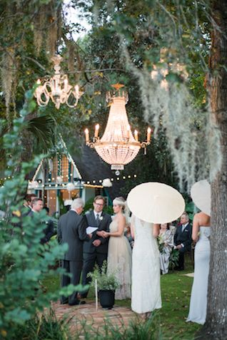 Outdoor chandelier | LH Photography | see more on:  http://burnettsboards.com/2015/04/vintage-glam-wedding/