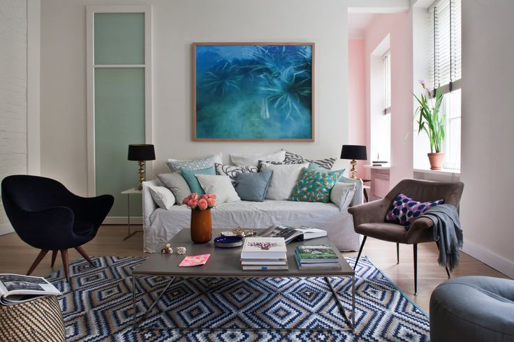 Sofa Ghost by Gervasoni surrounded by art and sophisticated accessories. Available at Showroom MOOD, Warsaw. #mood #gervasoni #ghost #sofa #beige #pillows #blue