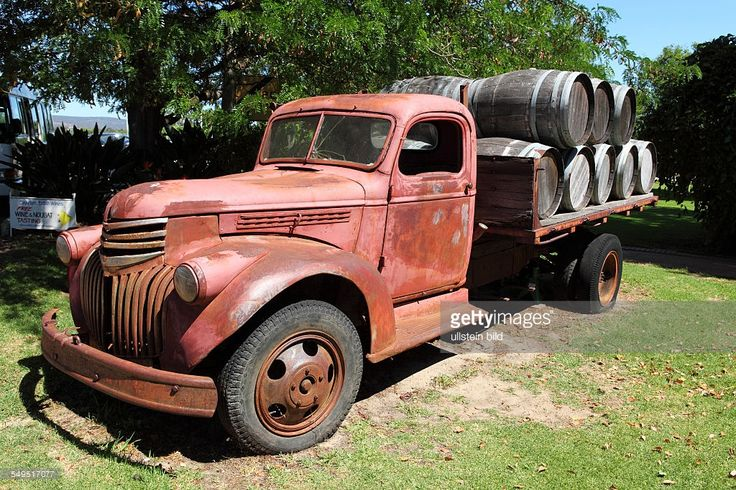 An old Chevrolet truck laden with wooden wine barrels at Guildford ...