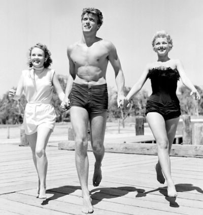 Clint Eastwood with actresses Olive Sturgess and Dani Crayne in San Francisco, 1954