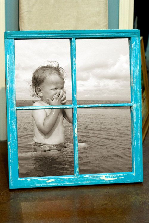 Old window photo frame  Via mommo design. Black and white photo behind a painted frame.