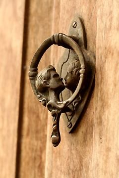 A sweet kiss...love this door knocker