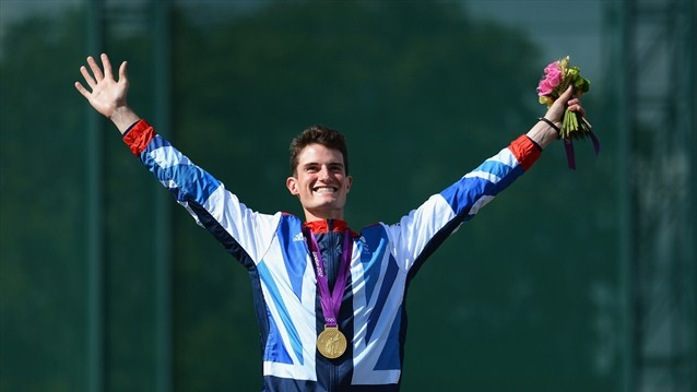 Peter Wilson of Great Britain celebrates with his gold medal during the Victory Ceremony following the men's Double Trap Shooting final on Day 6 of the London 2012 Olympic Games at The Royal Artillery Barracks