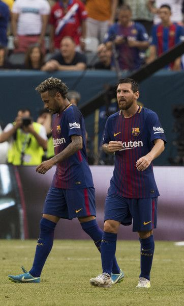 Neymar (L) and Lionel Messi of FC Barcelona walk up the pitch after Neymar's second goal during the International Champions Cup (ICC) match between Juventus FC and FC Barcelona, at the Met Life Stadium in East Rutherford, New Jersey, on July 22, 2017. / AFP PHOTO / DON EMMERT