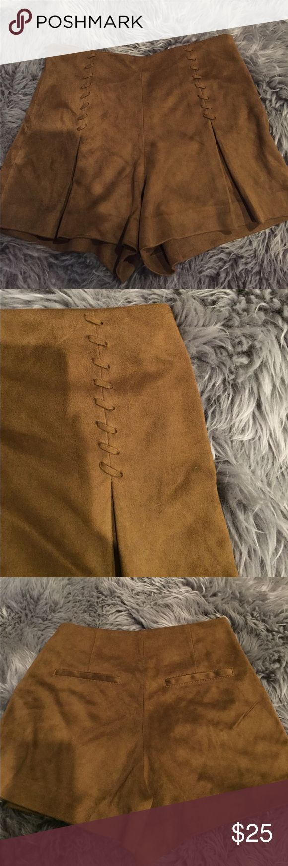 Brown suede shorts Adorable pleated brown suede shorts from MANGO! They have a lace up detailing on the front, a side zipper, and fake pockets in the back. They are SO CUTE!! Size 2 and I'm perfect condition! Mango Shorts