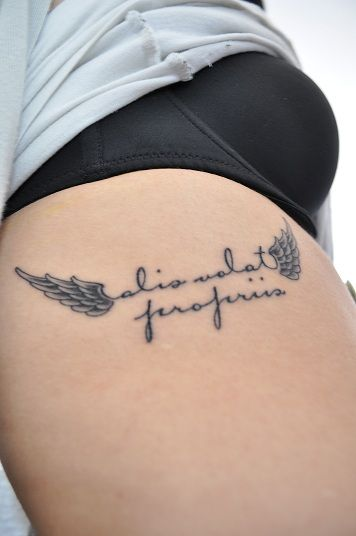 alis volat propriis (she flies with her own wings)